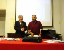 Enrico Luciani apre l'ordine del giorno per decidere sui vari punti all'ordine del giorno: accanto a lui Roberto Calabria